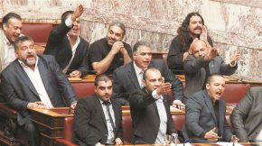 Racist delirium by Golden Dawn in the Parliament