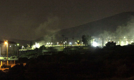 Smoke billows from the Amygdaleza detention centre, near Athens